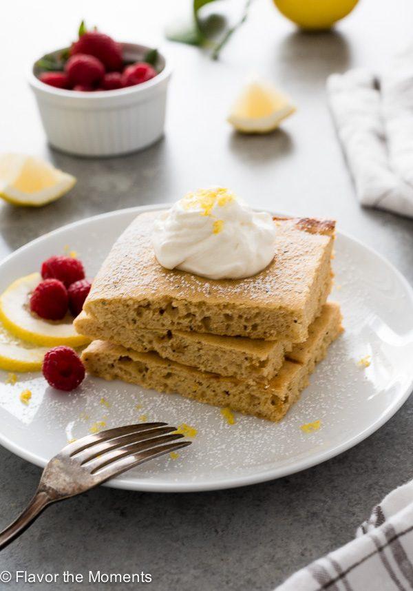 Stack of lemon poppy seed sheet pan pancakes on white plate