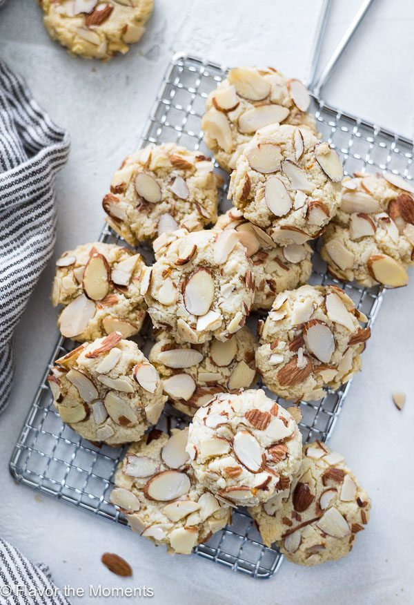 Greek almond cookies piled on wire rack
