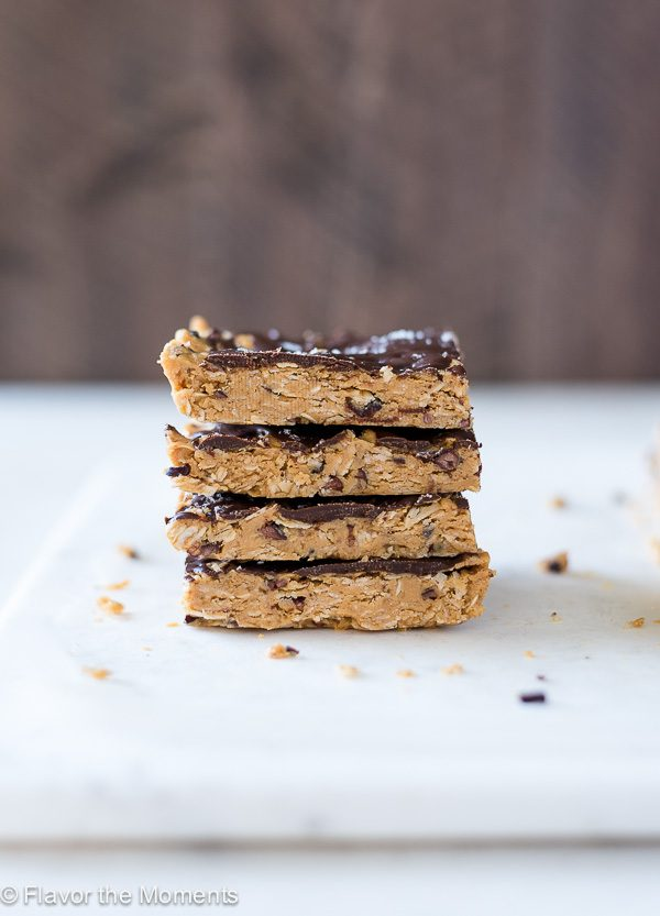 front view of no bake peanut butter oatmeal bars stacked up with wood background