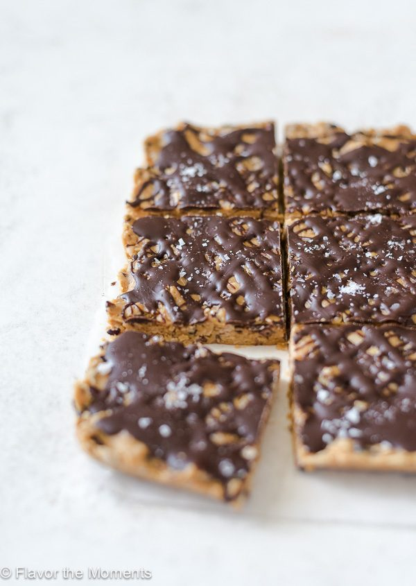 no bake peanut butter oatmeal bars sliced into squares with bottom left square pulled away