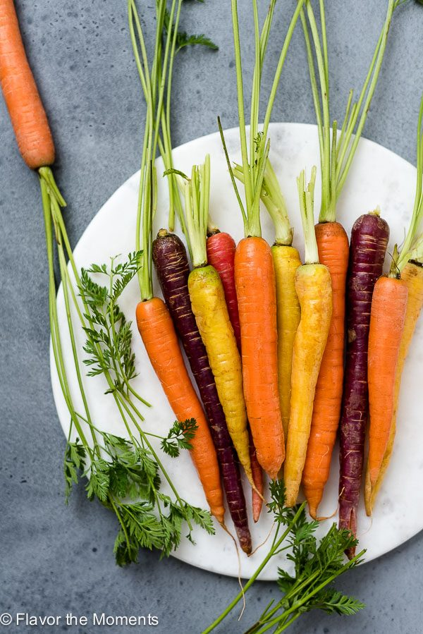 overhead view of carrots on a white plate