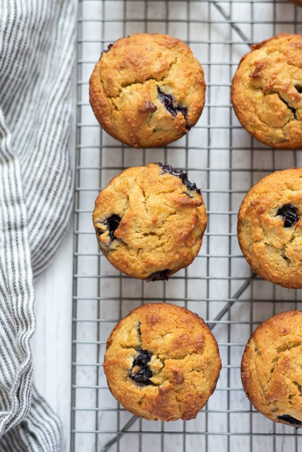 overhead shot of almond flour blueberry banana muffins on a wire rack