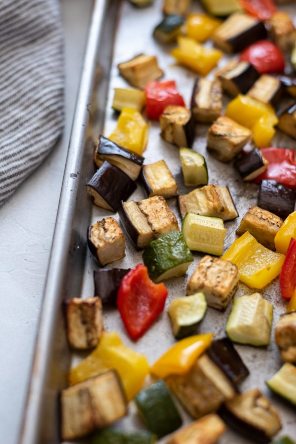 close up of roasted vegetables for pesto quinoa bowls