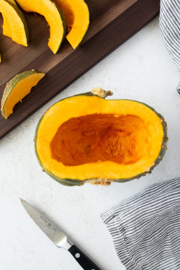 overhead shot of kabocha squash cut in half without seeds