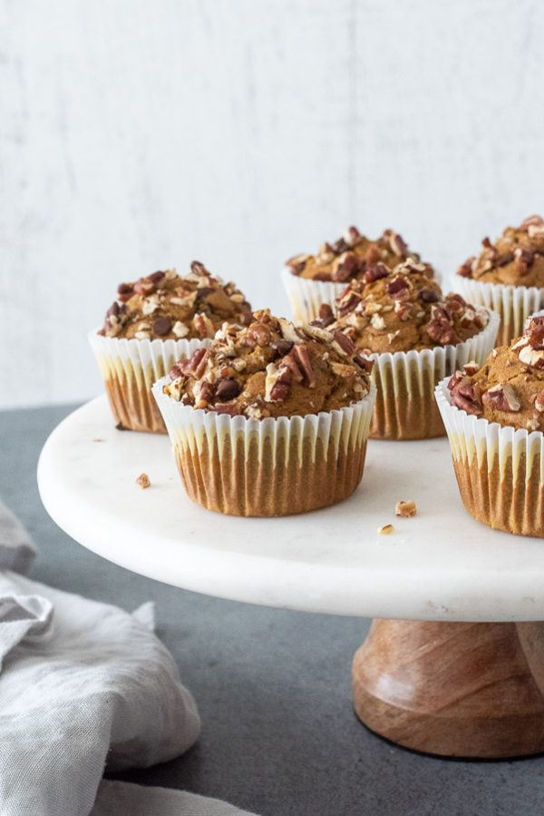 front shot of healthy pumpkin muffins with chocolate chips and pecans