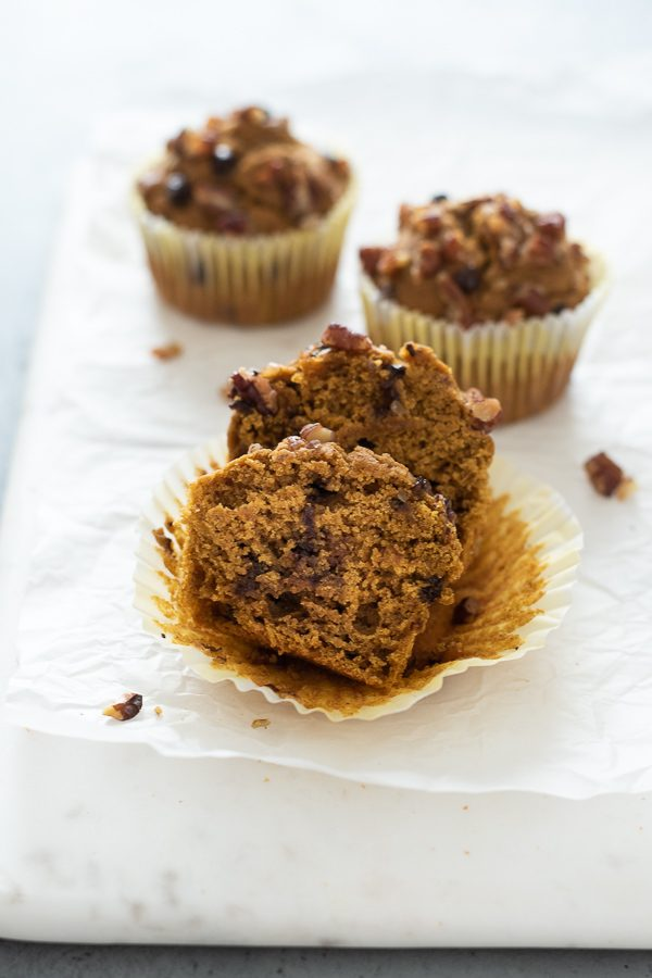 healthy pumpkin muffins cut in half with paper liner removed
