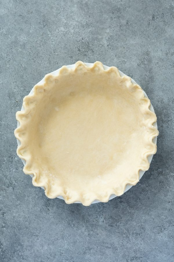 flaky pie crust crimped in pie plate