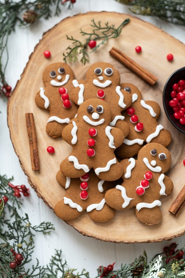 Gingerbread cookies piled on a server with cinnamon sticks