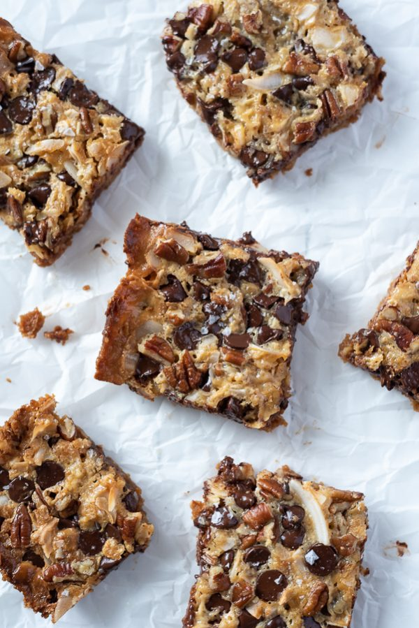 overhead shot of seven layer magic bars on parchment paper