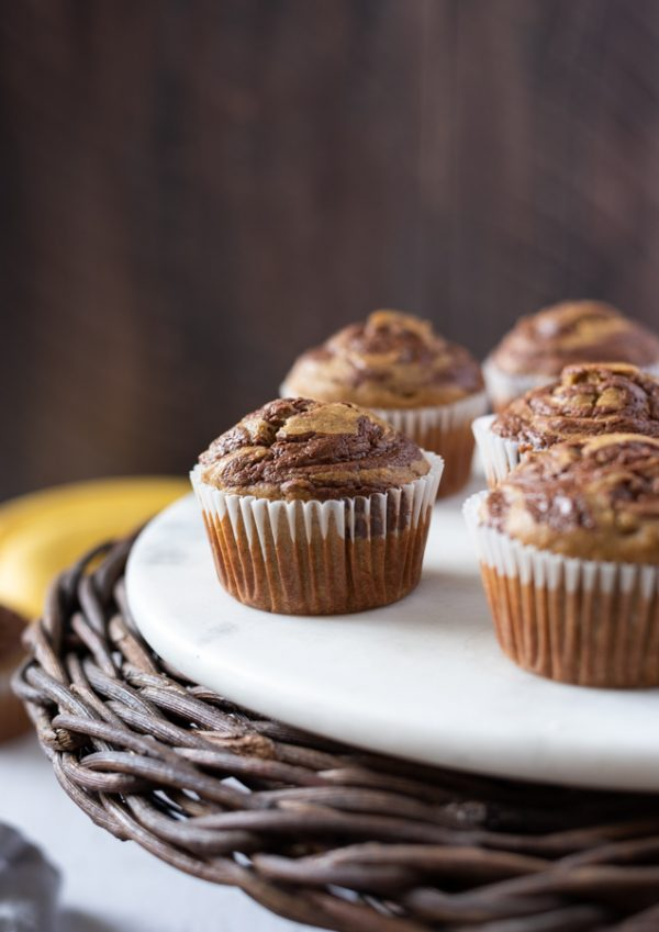 banana nutella muffins on a white marble server