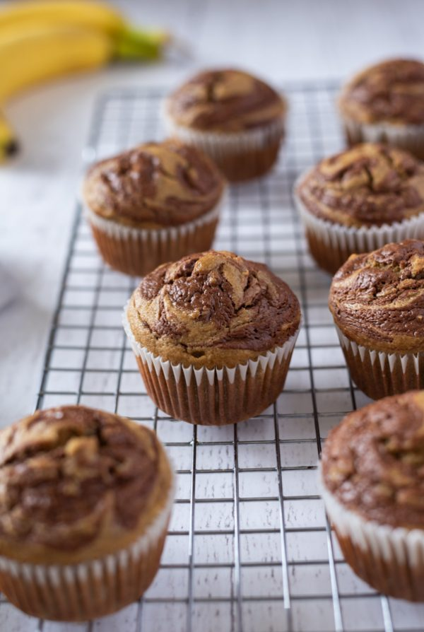 banana nutella swirl muffins cooling on wire rack