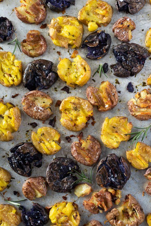 crispy smashed baby potatoes on baking sheet overhead shot