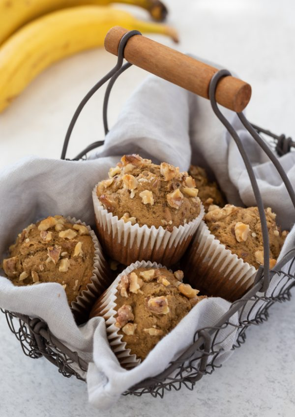 oat flour banana muffins piled in wire basket