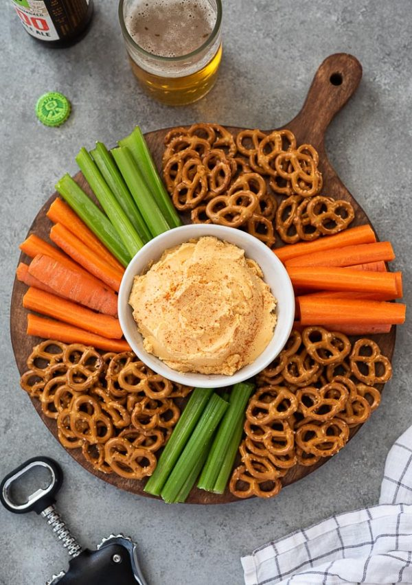 overhead shot of pub cheese platter with carrots, celery and pretzels