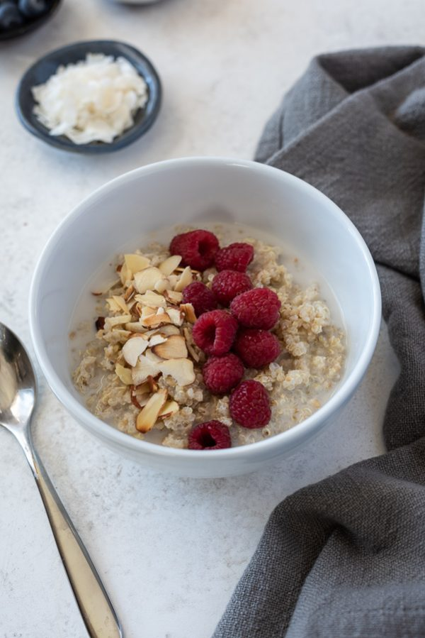 close up vanilla almond raspberry quinoa breakfast bowls