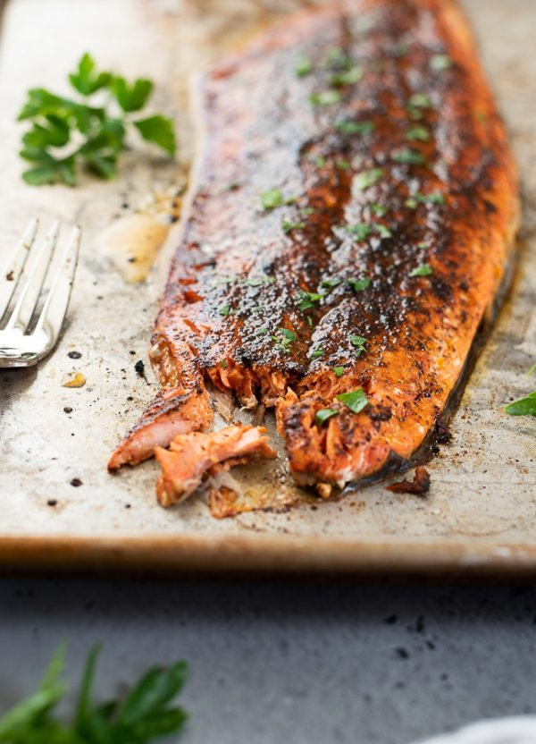 front shot of broiled salmon with salmon rub flaked with a fork
