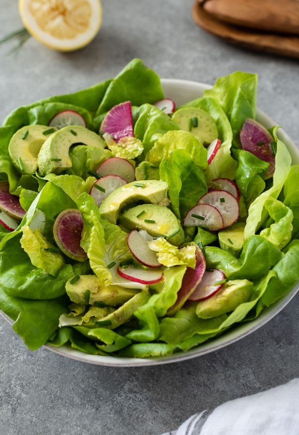 close up front shot of butter lettuce salad recipe in white serving bowl