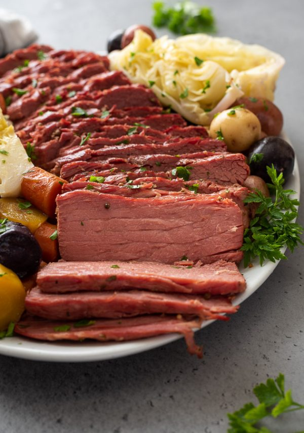 close up front shot of instant pot corned beef and cabbage on a white platter