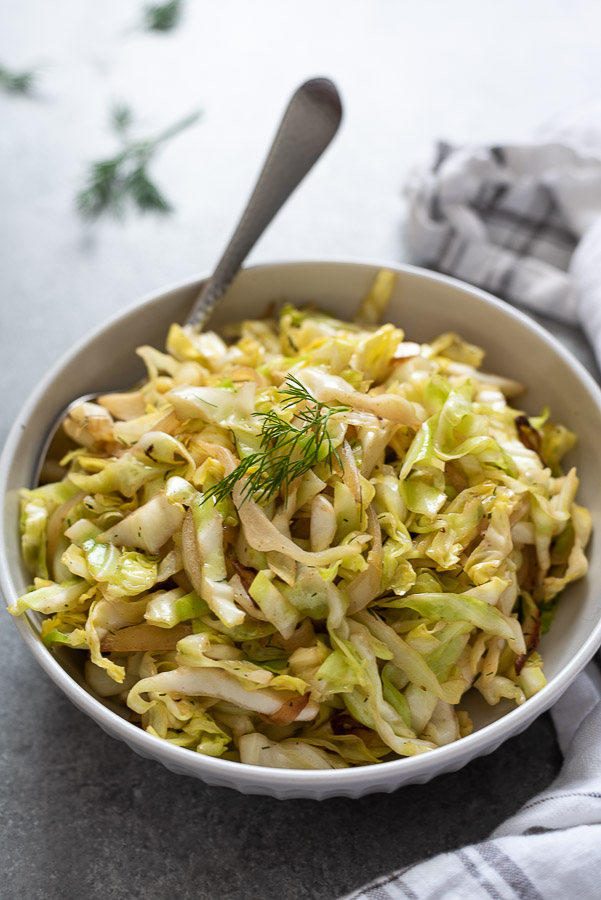 close up of sautéed cabbage in white serving bowl