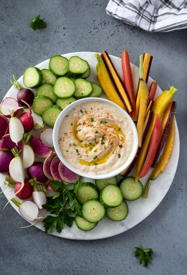 white bean hummus recipe presented on a platter with fresh veggies