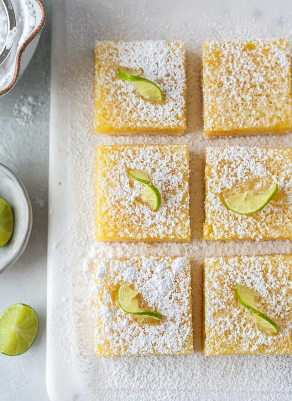 overhead shot of key lime bars on white serving board