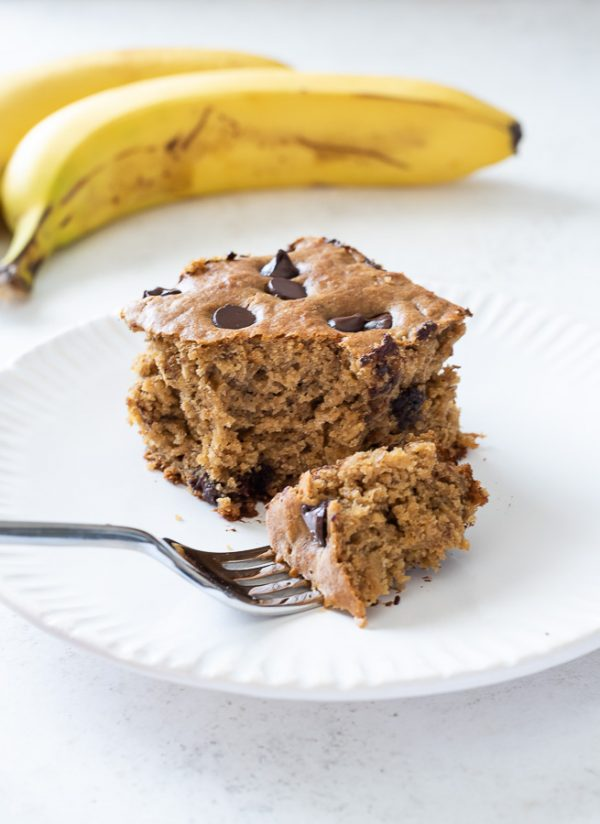healthy banana cake on a plate with a bite on a fork