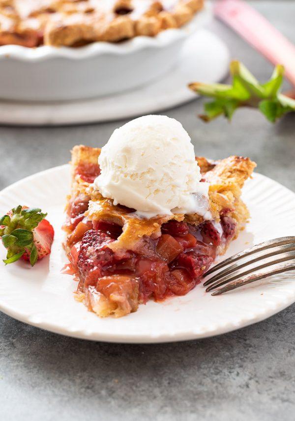 close up of strawberry rhubarb pie a la mode