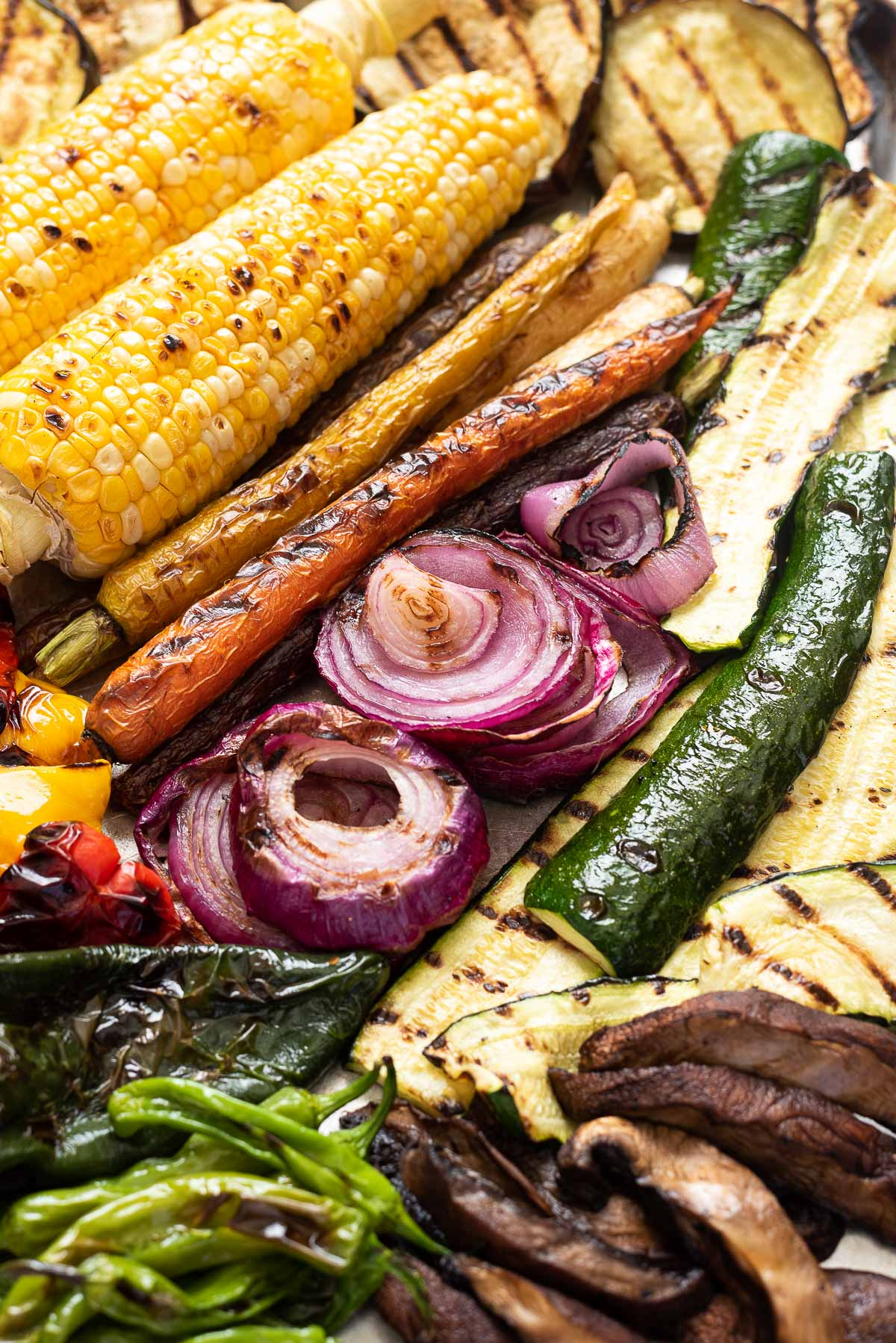 Close up of grilled vegetables on a baking sheet