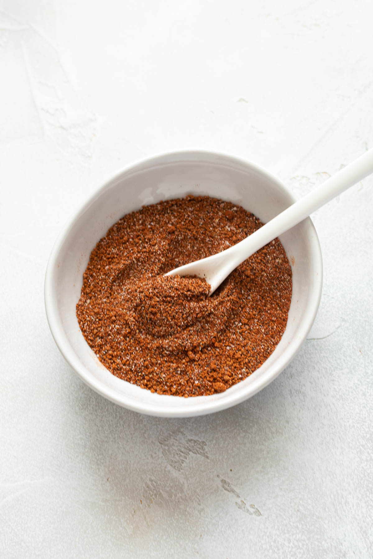 bbq chicken rub in bowl with spoon in the middle