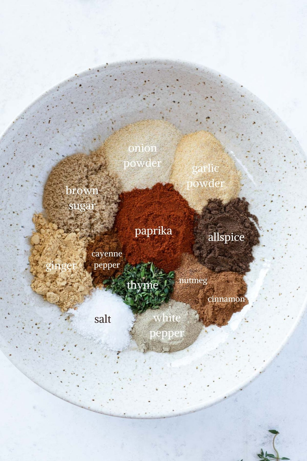 Homemade jerk seasoning ingredients in white bowl