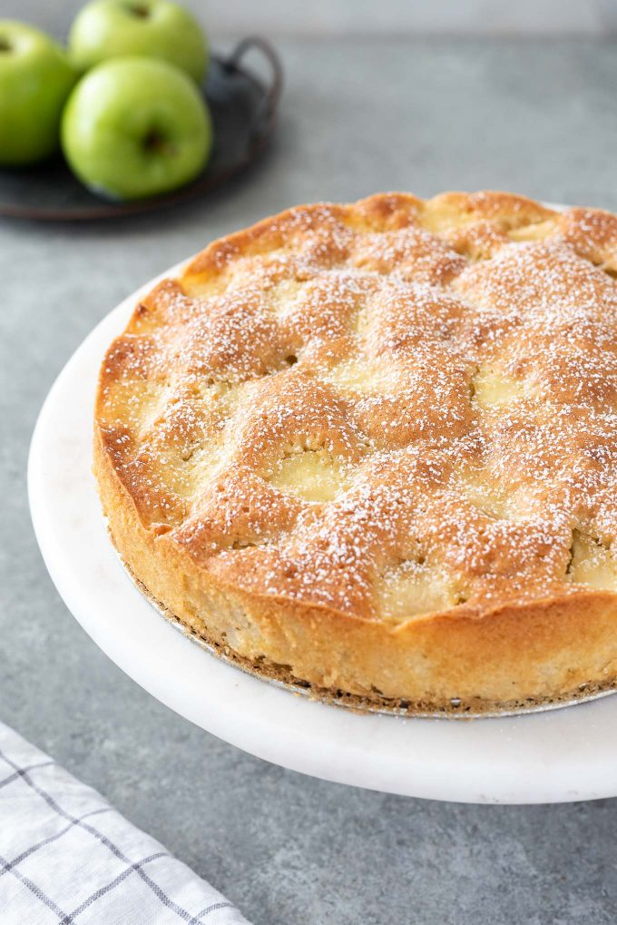 french apple cake dusted with powdered sugar