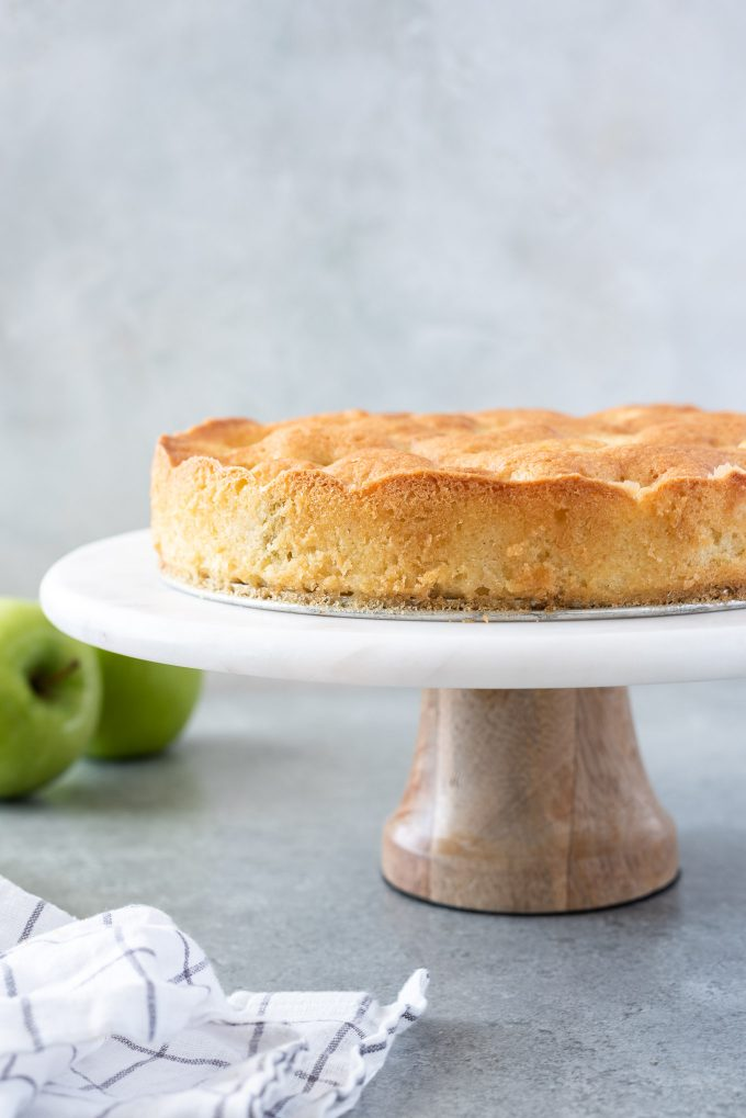 french apple cake on a cake stand