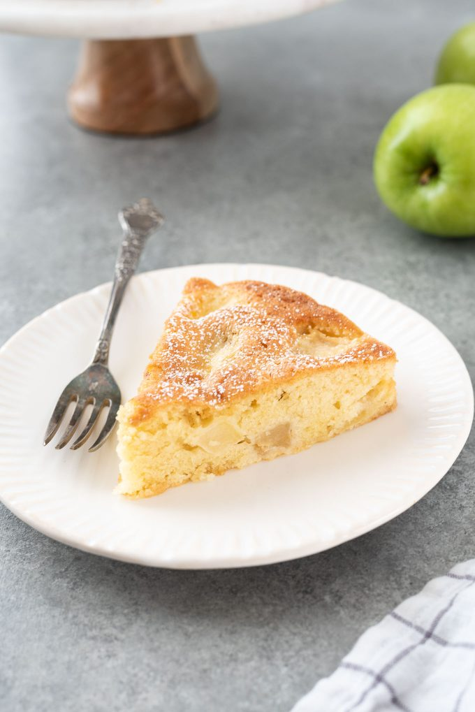 slice of french apple cake on a plate