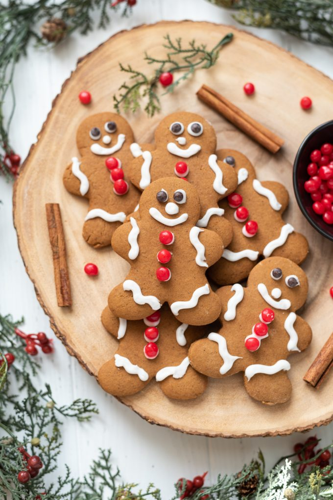 Soft gingerbread cookies piled on a wooden server