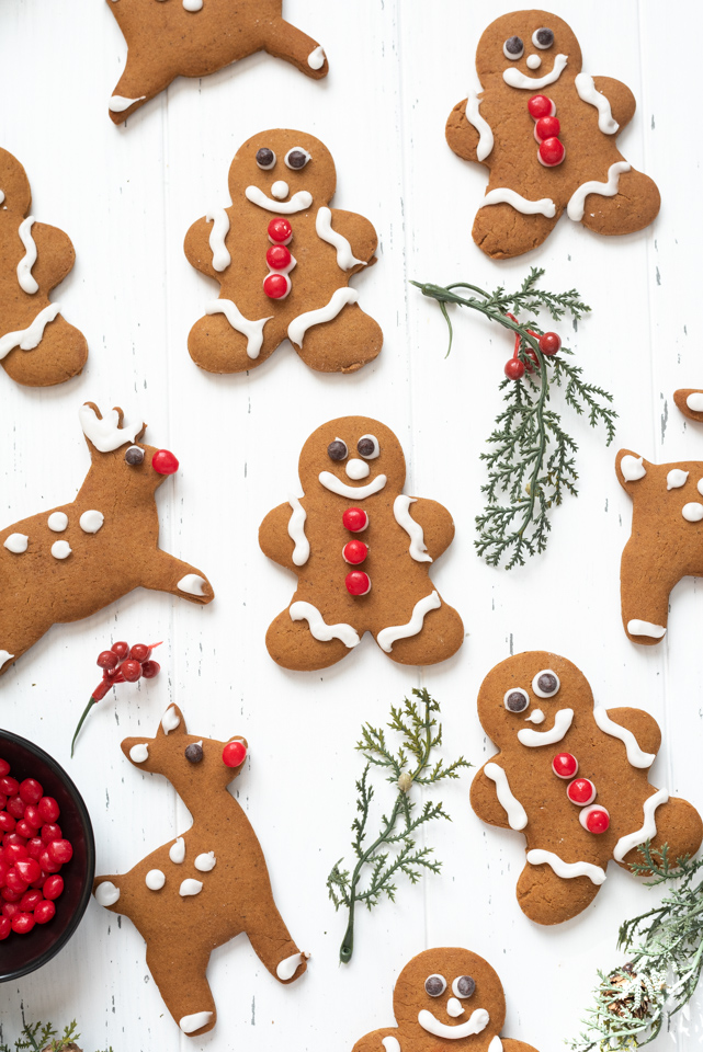 Assortment of gingerbread cookies with holly branches