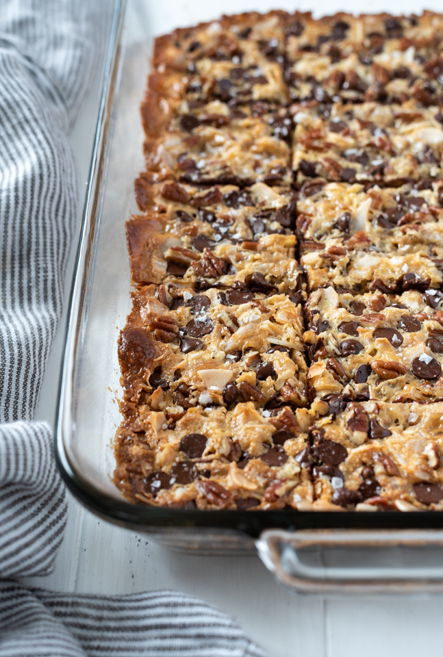 Seven layer cookies cut into squares in baking dish