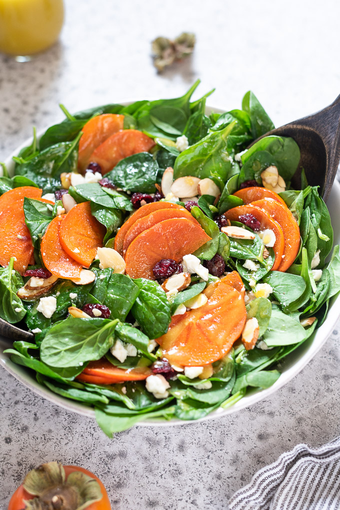 Close up of persimmon salad in a bowl