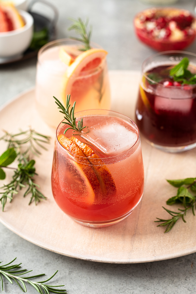 Blood orange vodka spritzer with rosemary sprig