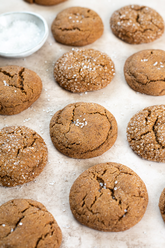 Array of gingersnap cookies with a bowl of sparkle sugar