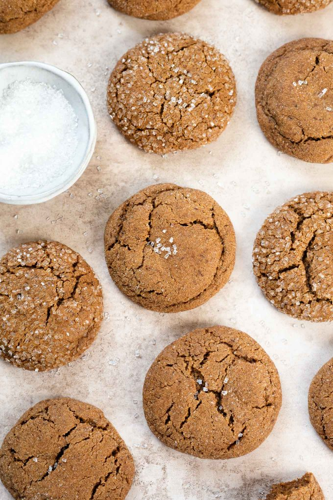 Soft gingersnap cookies laying flat with sparkle sugar