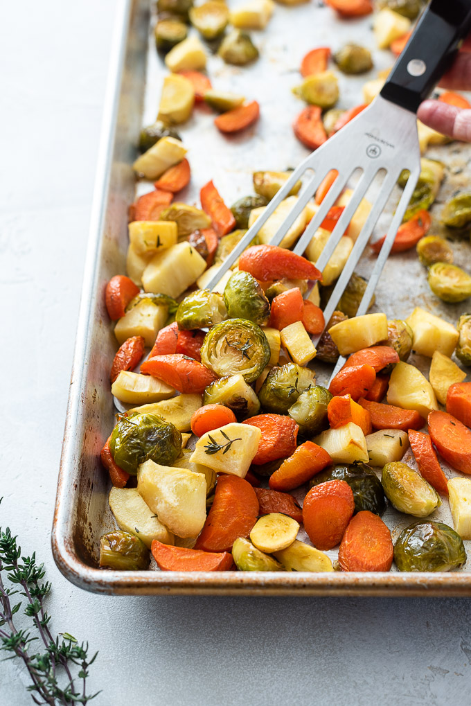Roasted brussels sprouts carrots and parsnips on a sheet pan