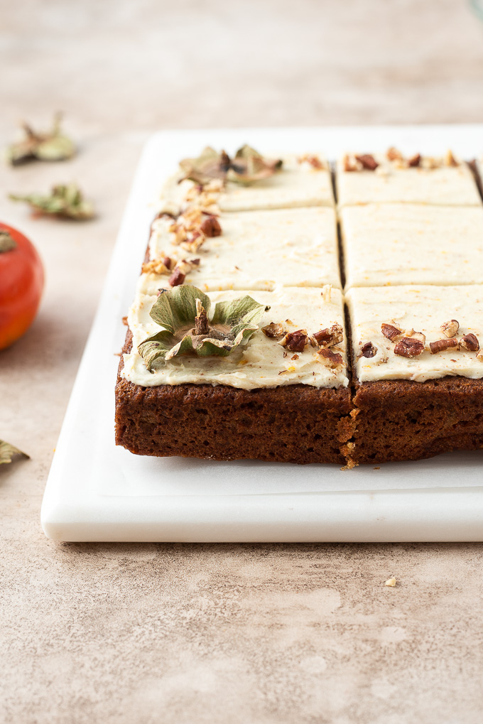 Close up of persimmon cake on serving board