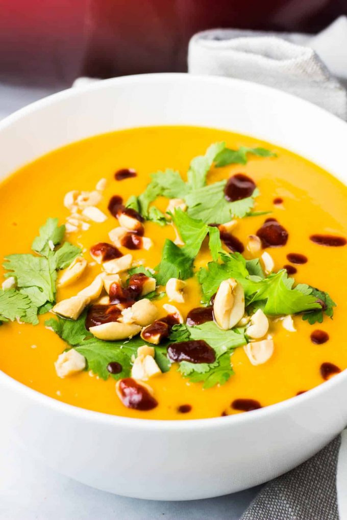 Vegan sweet potato soup with peanuts and cilantro on top