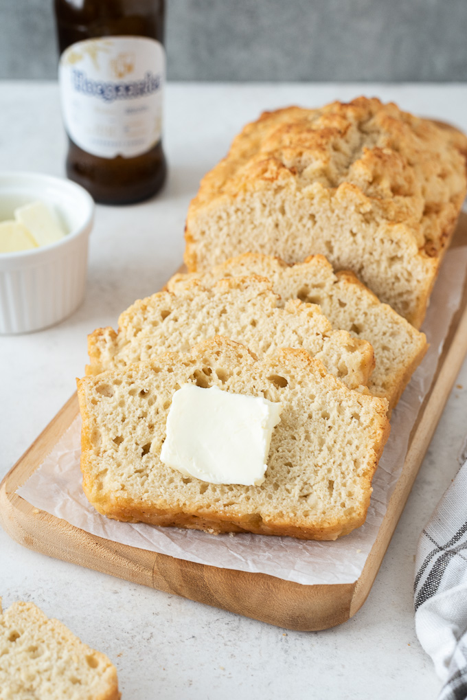 Slice of beer bread with a pat of butter