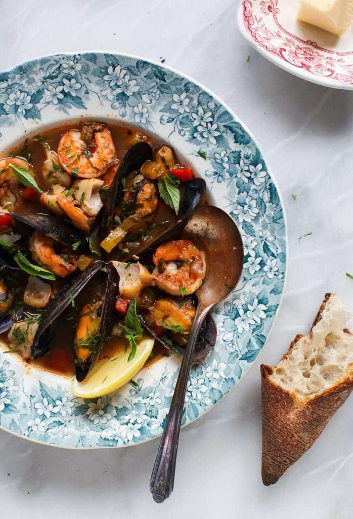 Cioppino in a bowl with crusty bread