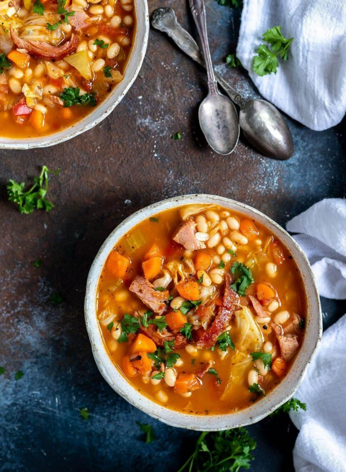 Bowls of ham and bean soup with spoons