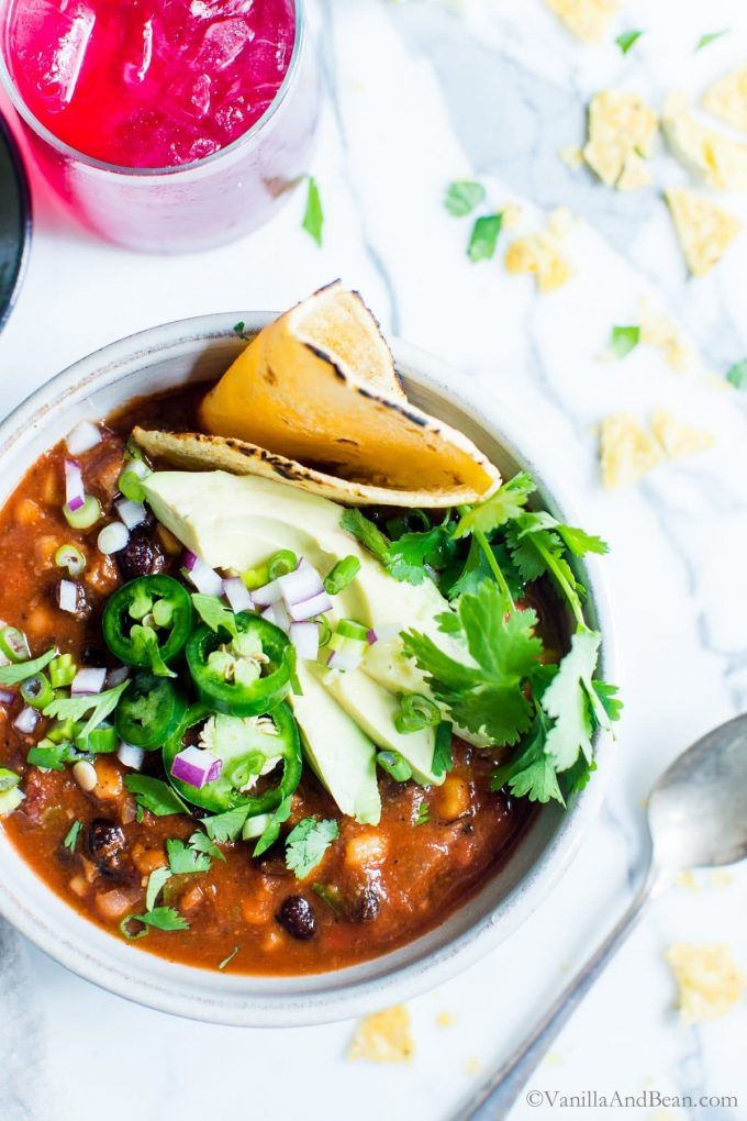Vegetarian taco soup in a bowl with avocado and jalapeno