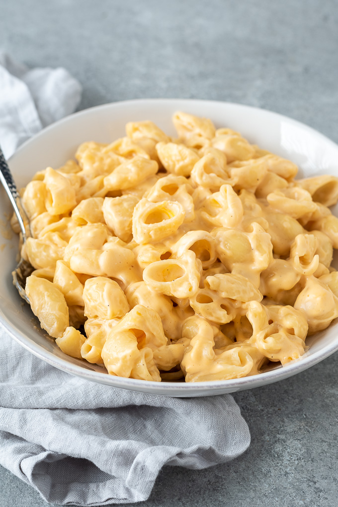 One pot mac and cheese in a bowl with serving spoon
