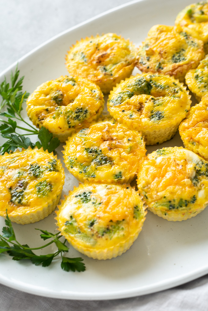 Crustless mini quiche on a platter with parsley