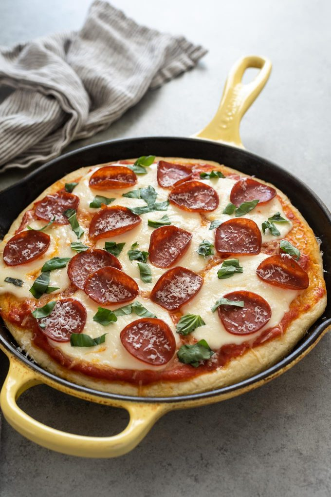 Focaccia pizza with pepperoni and torn basil